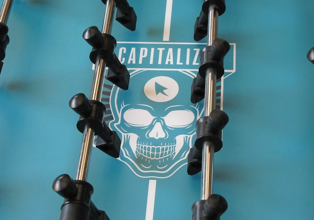 Company Logo playfield on Warrior Foosball Table for Capitalize