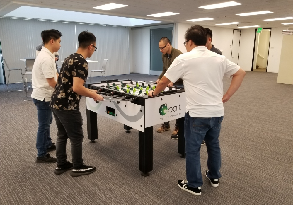 Balt USA employees having fun with their new Warrior Custom Foosball Table