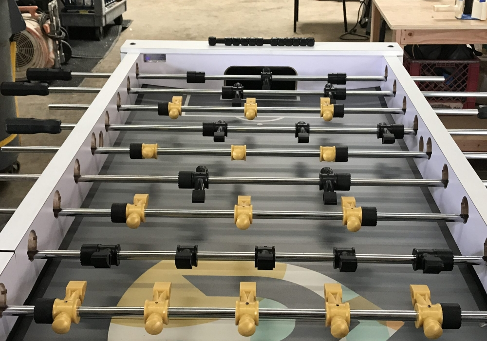 Multi-player foosball table custom built for Hollis Brand Culture
